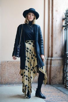 b0660f5b61 Pair a kerchief skirt with leather boots and a turtleneck for this look.  Férfi Divat