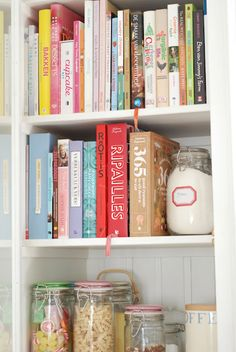 Shelfs with cookery books and jars. Nice colors. [ From: http://littleemmaenglishhome.blogspot.com ]