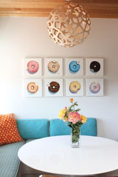 Eight 12x12 donut oil paintings in the home of a collector  - by Terry Romero Paul