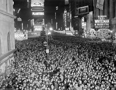 Party: 'As clocks, accompanied by whistles, sirens and other noise-making instruments, sounded the knell of 1938, this immense crowd in Times Square, shown surrounding a trolley car, gave vent to its feelings with a roaring acclaim for 1939,' reads the original caption