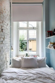 Cozy bedroom, white linen bedding and natural light from window love x