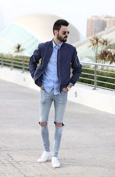 Amazing look with this Navy Bomber Jacket, Light Blue Shirt, Grey Ripped Jeans and White Sneakers
