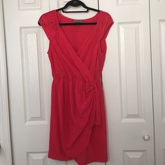 Red dress from Charlie Jade Red dress from Charlie Jade. Cinched at waist with detail. Purchased from South Moon Under only worn once! Great for wedding or formal party. Charlie Jade  Dresses Wedding
