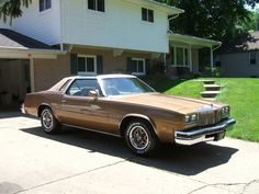 gold 76 cutlass supreme with a t-top. MY CAR MOFOS.