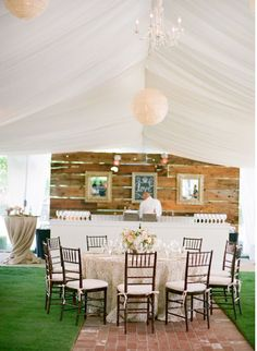 Obsessed with the idea of a wooden plank wall in an all white wedding tent...beautiful and rustic.