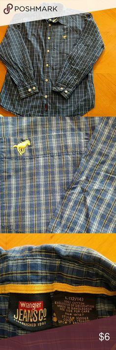 Wrangler button up Wrangler boys button up shirt. Boys size 12/14. Excellent condition. Smoke free home. Blue plaid Wrangler Shirts & Tops Button Down Shirts