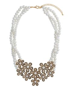 Sweet daisies with pearly strands, clear gem accents and ball bead petals.  Sweet necklace. <3