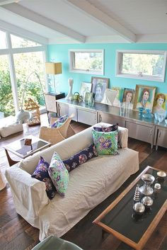Family room & big window, via Flickr.  Lovely cushions and colour from the divine Amy Butler