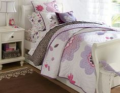 I love the Pottery Barn Kids Purple Reign quilt! I like the way the flowers are quilted randomly on it.