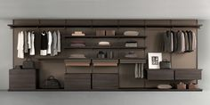 brown aluminum structure, back panels and shelves in coal larch melamine finish. Drawer units in coal larch melamine finish with top in regenerated castoro leather.