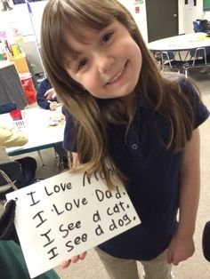 "Great blog, ""Kindergarten-Friendly Handwriting Matters!"", about supporting kindergarten writers! FREE DOWNLOADS include Name Ticket practice book. This girl has just completed a fluency activity where she practiced writing ""heart word"" sentences with good handwriting. For a proven approach to Kindergarten Handwriting, see Nellie Edge Online Seminar #2 at https://onlineseminars.nellieedge.com/"