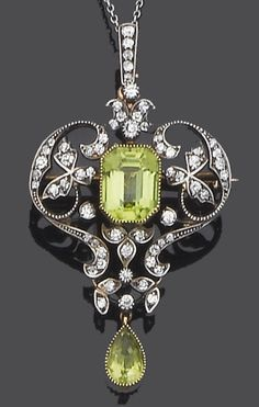 An early 20th century peridot and diamond brooch/pendant, circa 1900 The step-cut peridot within an openwork single-cut diamond surround of foliate and scroll design suspending a pear-shaped peridot drop, with diamond-set suspension loop to a fine trace-link chain, mounted in silver and gold, diamonds approx. 0.80ct. total, pendant length 5.2cm., original fitted case