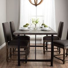 Enjoy entertaining your friends and family around this rectangle dining table. The Renate wood dining table features a sleek and simple design that complements a variety of decor styles. Spacious enou