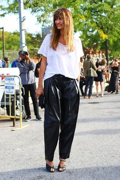 Caroline de Maigret in slouchy, pleated black leather pants. Photo by Phil Oh. #streetstyle #harempants
