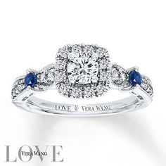 "The diamond, the band, I love it all!    ""From the Vera Wang LOVE Collection, this eye-catching engagement ring features a 1/3 carat round center diamond framed by accent diamonds. The ring's diamond-lined band features two round sapphires that add color and sparkle, a signature of the collection and a symbol of faithfulness and everlasting love."""