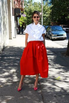 Carven blouse, Tibi skirt, Jimmy Choo pumps and Oliver Peoples sunglasses.