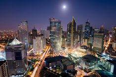Makati Skyline at night. Makati is a city in the Philippines` Metro Manila region and the country`s financial hub. It`s known for the skyscrapers and shopping malls. Free Travel, Us Travel, Rizal Park, Passport Services, International Flight Tickets, Hostels, Makati City, Banaue, Jeepney