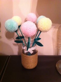 Pastel pompom flowers in a twine wrapped jar