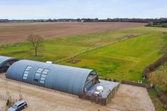 A FORMER World War II airfield hanger that was converted into a five-bed luxury home has been put up for sale. The historical property, located in Dunmow, Essex, has gone on the market for a staggering £1.4million. SWNSThe hanger is located in the countryside in Dunmow, Essex[/caption] SWNSThe WWII hanger was converted into a luxury five-bedroom home[/caption] The hanger was one of the thousands of ...Nissen huts... erected in the UK during war-time using pre-fabricated sections and with distinc Norway News, Essex Countryside, Airy Bedroom, Luxury Sale, Natural Pond, Liverpool Street, Timber Door, Unique Buildings, Georgian Homes