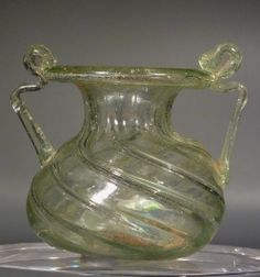 Roman clear glass jar with two handles.  								  								3rd – 4th century AD.
