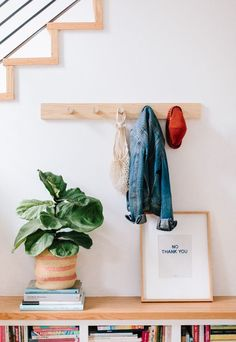Totally Hooked: How to Make a Wood DIY Peg Rail Organizer. Click through for the tutorial. #woodproject #wooddiy #diyidea #diyproject #diywallhooks #wallorganizer