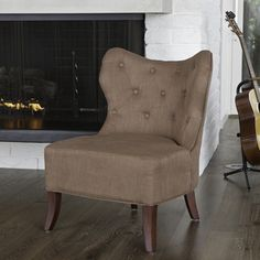 @Overstock - Sporting a stylish design, this elegant fabric accent chair adds classic beauty to any room. This chair features an appealing bronze finish complemented by walnut-wood stained legs. Its comfortable cushion and graceful design makes it a stand-out piece.http://www.overstock.com/Home-Garden/Christopher-Knight-Home-Genevieve-Bronze-Fabric-Accent-Chair/7294873/product.html?CID=214117 $205.99