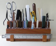 About three years ago, I got tired of never being able to find the basic tools that I used the most. I kept them in a couple of cans at my workbench, and they ended up all over the place by the end of the day. I decided to first analyze which tools I… Bookbinding Tools, Bookbinding Tutorial, Workshop Storage, Tool Storage, Garage Storage, Bric À Brac, Support Mural, Shop Organization, Organizing
