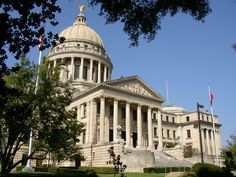 The Mississippi State Capitol in Jackson, Mississippi. An 8-foot-tall  15-foot-wide  eagle soars above the dome, made of solid copper and gilded with gold leaf. One of the 53 replicas of the original Liberty Bell, as well as a statue erected in memory of the ladies, mothers, sisters, wives and daughters of the Confederate soldiers is located on the capitol grounds.