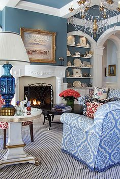 Blue and white living room with pops of coral - love the ble lamp - home in Palm Beach by Seldom Scene Interiors