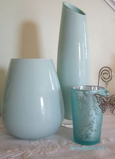 Transform dollar store vases elegantly with leftover paint.