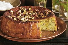 Pistachios add a delicious nutty flavour to this light zesty cake.