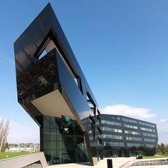 A black cantilevered office building in Graz, Austria