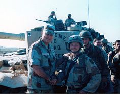 Allen C. Smith, 1st Platoon, Company C, 2nd Battalion, 16th Infantry Regiment, 1st Infantry Division, right, shakes hands with Gen. Norman Schwarzkopf.