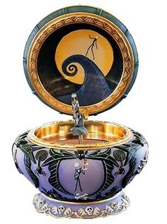 """NIGHTMARE BEFORE CHRISTMAS SALLY MUSICAL JEWELRY BOX This eerie jewelry box, inspired by Tim Burton's the Nightmare Before Christmas, opens to reveal the seamstress Sally   Wind the key on the bottom and Sally turns to the tune of """"This Is Halloween""""   Painted by hand, the outside of the box features delicate bas relief scenes.   Size: approx. 6.5"""" x 4.75"""" diameter   Materials: sculpted resin  Musical Box 2004 389.99+20.00"""