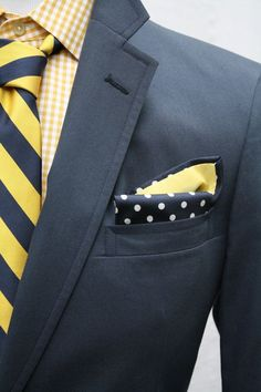 Shop this look on Lookastic:  http://lookastic.com/men/looks/yellow-long-sleeve-shirt-yellow-tie-charcoal-blazer-navy-pocket-square/9035  — Yellow Gingham Long Sleeve Shirt  — Yellow Vertical Striped Tie  — Charcoal Blazer  — Navy Polka Dot Pocket Square