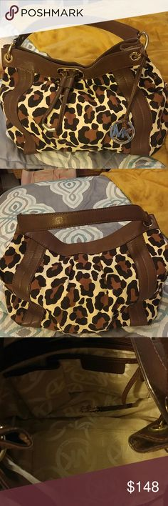 Michael Kors Animal Print Bag Great bag with wounderful accents.Used very little. Michael Kors Bags