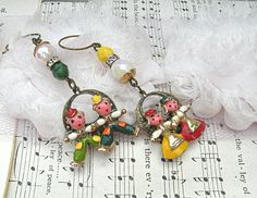 kitschy boy girl assemblage earrings mismatch by lilyofthevally