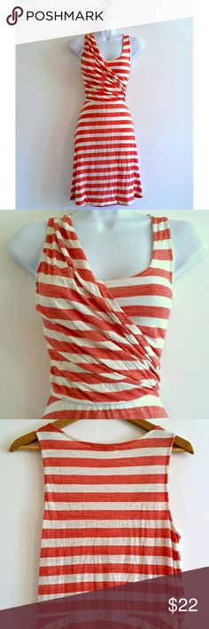 """(385) Wrap Bodice Striped Midi Dress - Size M Great casual dress from Gap in very good condition. Lightweight fabric has a wrap shape at the bodice. So incredibly flattering - really highlights your waistline. Red stripes throughout soft oatmeal cream shade. Chic midi length. Fun to wear, very versatile, and so form-fitting.   Bust - 35"""" Waist - 30-40"""" Hip - 57"""" Length - 38.5"""" Size - M (PLEASE CHECK MEASUREMENTS) Label - Gap  Color may vary slightly based on screen display.  #gapdress…"""