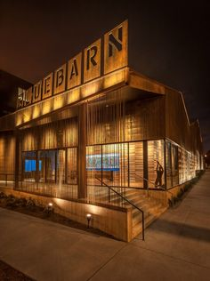 Architects clad this building in weathering-steel panels overlaid with thin strips of rebar. Illuminated by uplighting, the facades emit a golden glow in the evening.