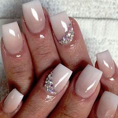 How gorgeous are these bridal nails? We love how they are ombre with beautiful rhinestone embellishments! Would you try this on your wedding day?