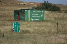 Only in South Africa, they pinch the road information signs to help them build their shacks