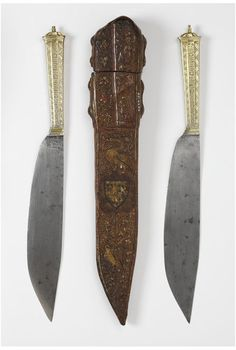"""AD 1400-1450 Burgundian steel, silver-gilt, and enamel carving knives, engraved in Latin with """"Mother of God, be mindful of me"""" and """"Hail Mary, full of Grace, the Lord be with you"""" and cuir bouilli case (Knife: 37.5 cm overall, 23.7 x 4.5 cm blade, 0.7-0.8 cm handle depth; Case 38.3 x 5.2-6.9 x 4.2 cm) - Victoria & Albert Museum 2239:1 to 3-1855"""