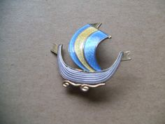 Aksel Holmsen Norway Enamelled 925 Brooch, £34.99 by Bettabuy Vintage:   A sterling silver enamelled ship brooch by Aksel Hollmsen of Norway.  It measures approx. 1 1/4 inches wide and 1 1/8 inch long with a roll over safety catch.  Marked on the back Norway Sterling925S and another mark which looks like two X\\\'s one on top of the other.  In excellent pre-owned vintage condition.  Enamel looks perfect.