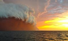 Taken by a tug boat worker in West Australia, Brett Martin has captured the moment a huge storm met the sunset and through the wind and rain released a massive amount of red dust it had collected while hurtling over land.