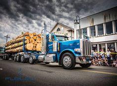 Blue Peterbilt log hauler