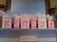 Double as decoration by spelling out the expected baby's name, and hold prizes for winners of baby shower games. Even better, fill them with things the new mom will need, so every win benefits her! Baby Shower Game Prizes, Baby Shower Gift Bags, Baby Shower Fun, Baby Shower Gender Reveal, Shower Gifts, Baby Bags, Shower Party, Diaper Shower, Shower Time