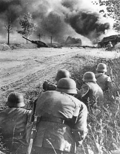 German Soldiers and Burning Soviet Tank on Eastern Front 1941.