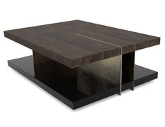 Lallan Centre Table  The Lowlands of Scotland are called Lallans, also designating the intergration, blending and combination of some Scottish dialects. The Lallan center table combines four different materials and finishes - dark walnut veneer, black lacquer, polished and aged bronze. All these components cross and integrate harmoniously, despite their asymmetry, to creat the Lallan.
