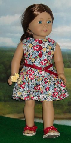 Floral ruffle dress by SugarloafDollClothes on Etsy. Made using the 1930's Ruffled Play Dress pattern. Get it here http://www.pixiefaire.com/products/1930s-ruffled-play-dress-18-doll-clothes. #pixiefaire #1930sruffledplaydress