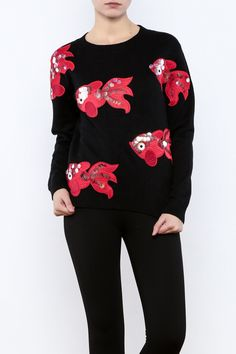 This sweater has cute sequined detailed fish patterns throughout, long sleeves and a crewneck.   All the Fish in the sweater by THINK CLOSET. Clothing - Sweaters - Crew & Scoop Neck Brooklyn, New York City Williamsburg, Brooklyn, New York City Manhattan, New York City